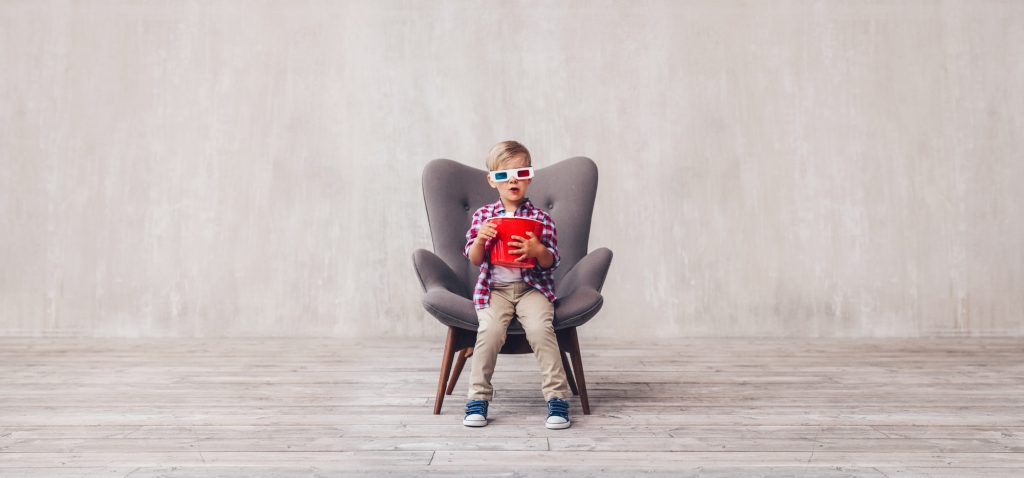 Little kid with popcorn in 3d glasses